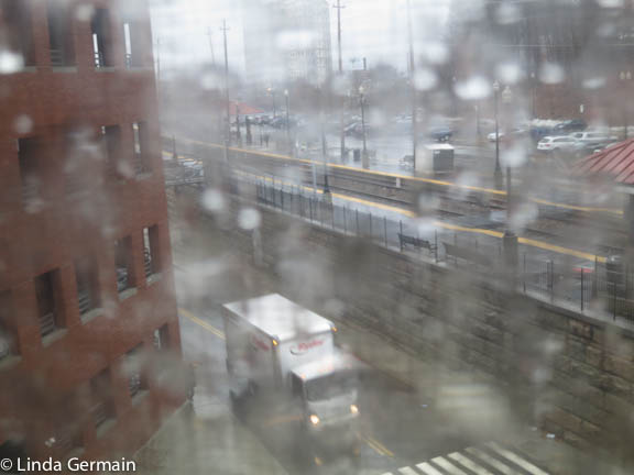 looking out the studio window - heavy rain - linda germain