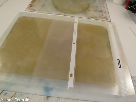 Page protectors make good covers for the homemade gelatin plate