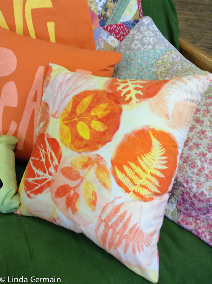 Monoprinted fabric used to make a pillow cover linda Germain