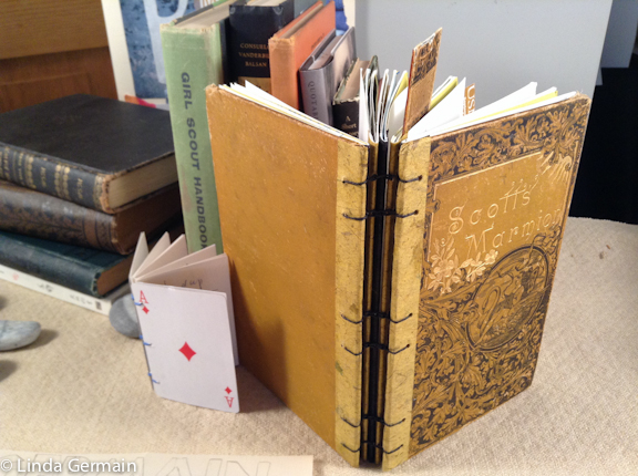 Altered book with coptic binding