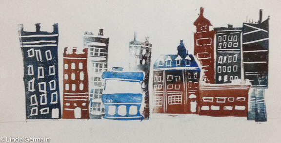 block print of cityscape based on drawing