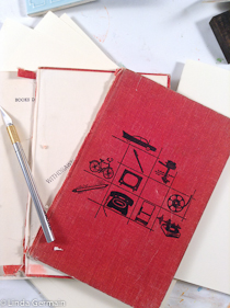 cut apart old books and make journal