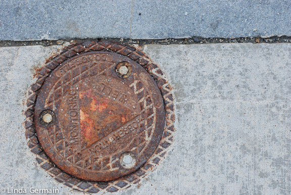 metal covers in the street inspire printmaking
