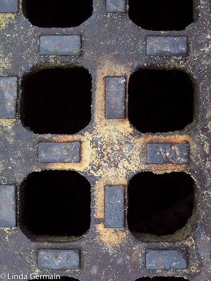 close up of drain in street